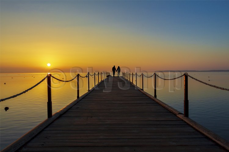 Loving couple meets the sunrise. Summer example image 1