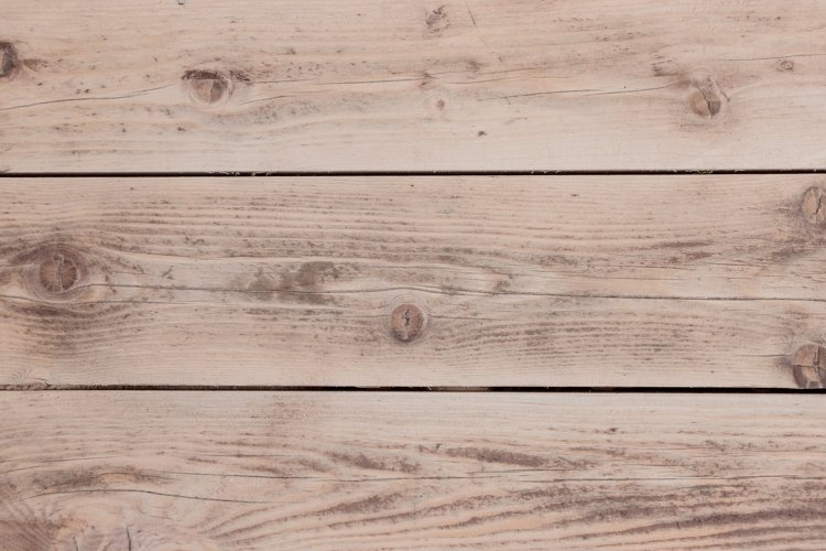 rustic weathered barn wood background with knots and holes.