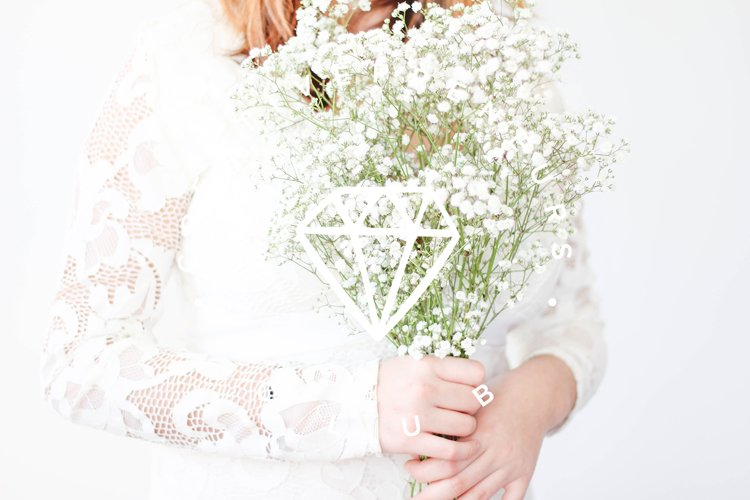 Woman Holding Flowers Styled Stock Photos