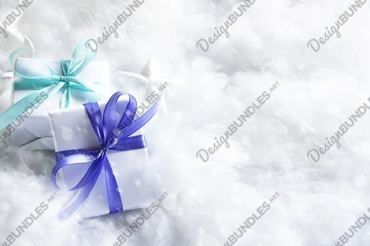 Christmas gifts in snow with copy space