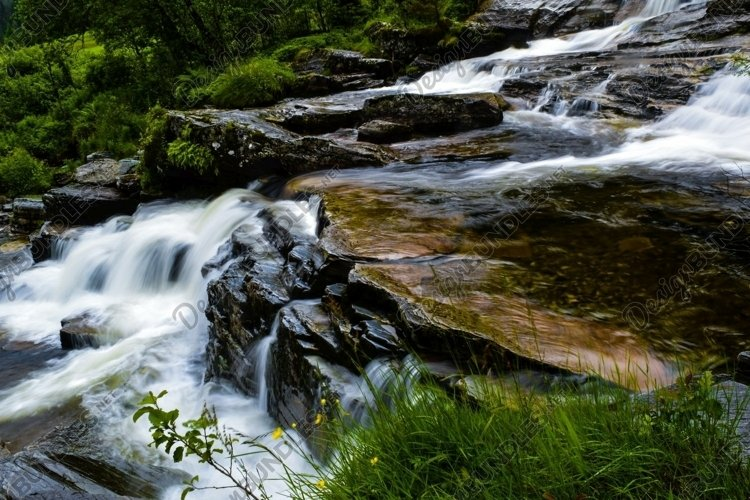 Motion blur clear water of river. Norway.