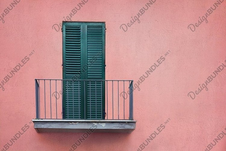 balcony with green wooden door with shutters on pink wall example image 1