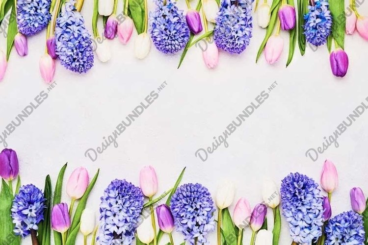 Colorful tulips and hyacinths border on light background. example image 1