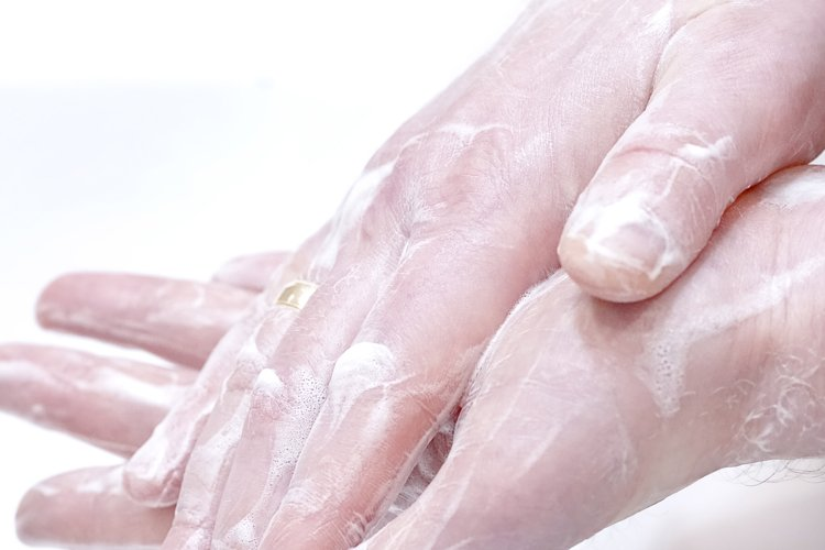 Man wash his hands with soap at home example image 1