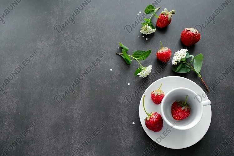Flowers, bright red strawberries in white cup. Copy space example image 1