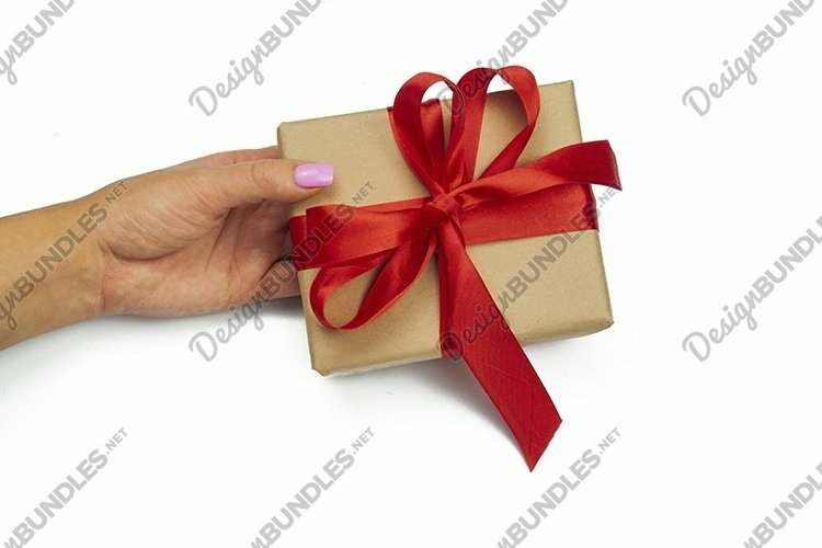 the girl is holding a gift box in her hand a surprise presen