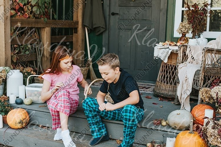 children a boy and a girl in pajamas sharing candy
