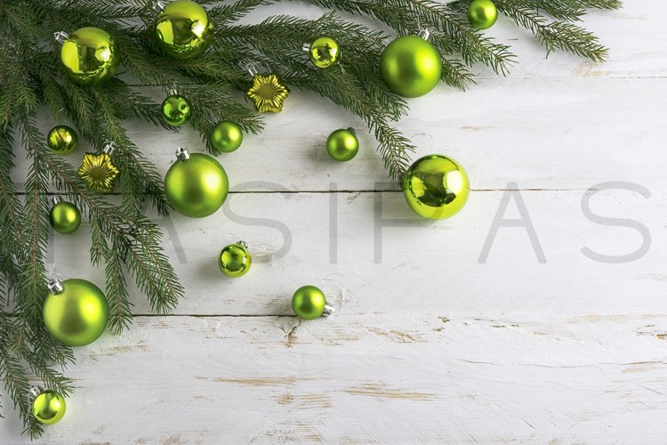 Christmas background decorated with green bauble hanging. example image 1