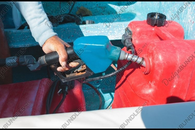 Man fueling tank of a motor boat before travel example image 1