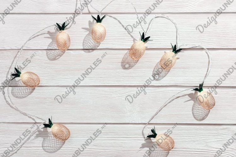 Home decorations with pineapple lights golden color example image 1