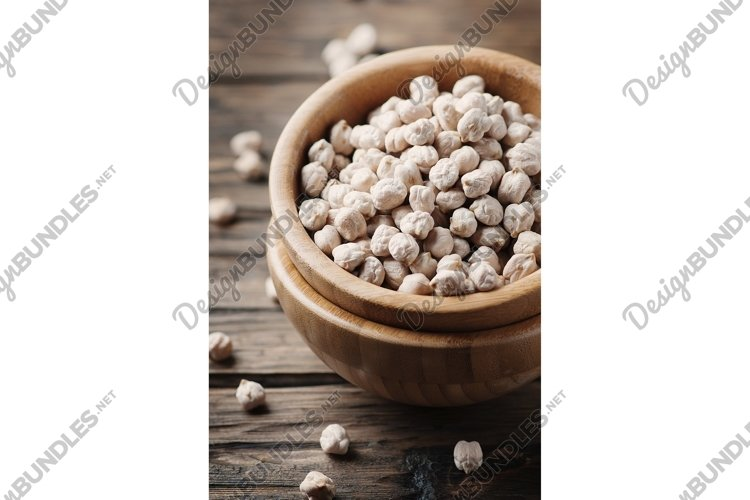 Uncooked chickpea on the vintage table, selective focus example image 1