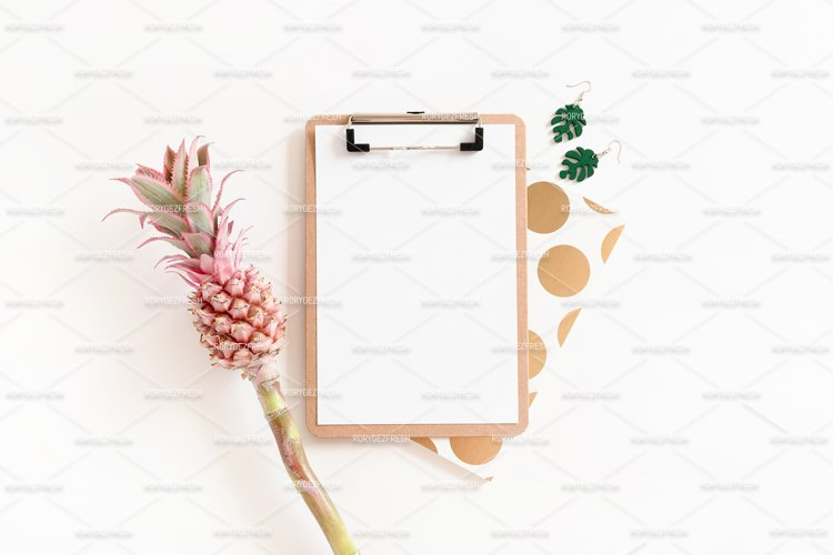 Flatlay of clipboard mockup, notepad, earrings example image 1