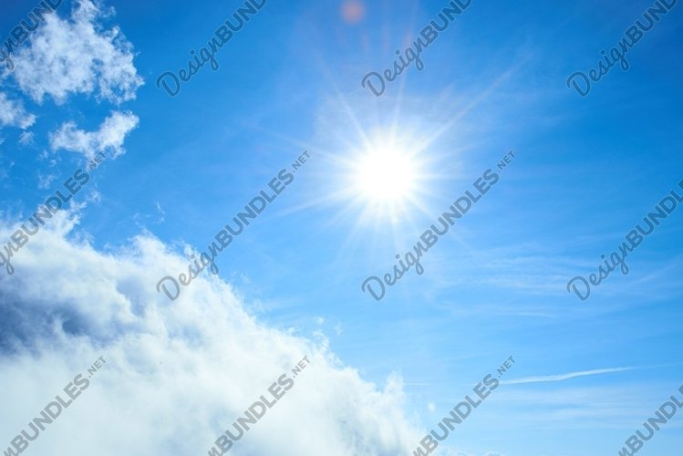 Beautiful blue sky with sun and clouds example image 1