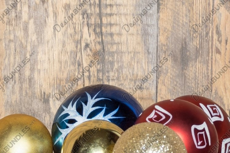 Colorful Christmas tree balls on a wooden background example image 1