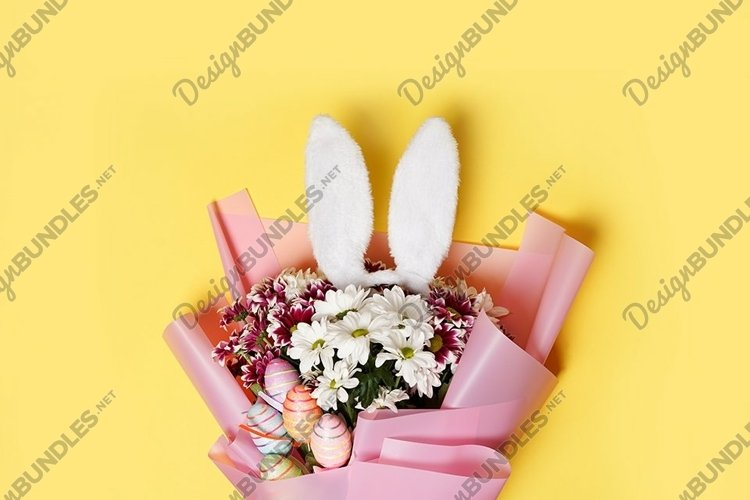 Easter bunny ears, spring flowers and colorful eggs example image 1