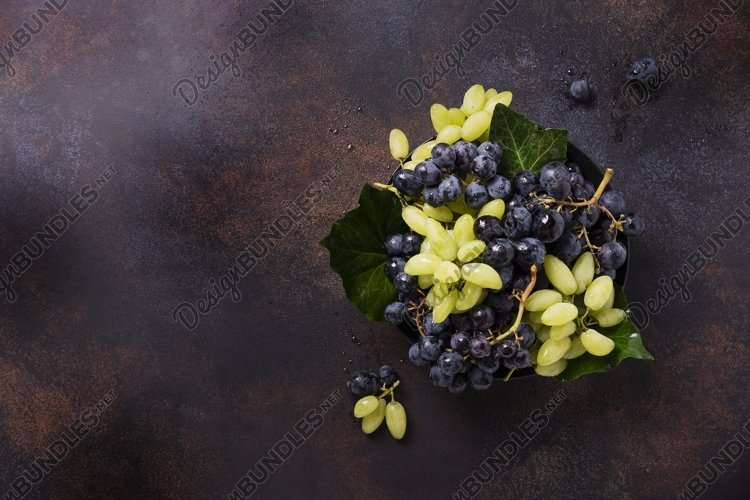 Mix of white and black grape on the dark background example image 1