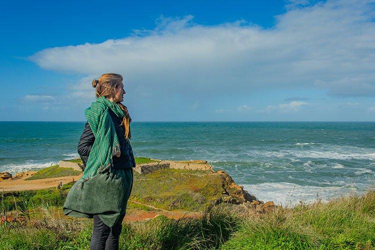 Woman dreamily looks at the Atlantic ocean. example image 1