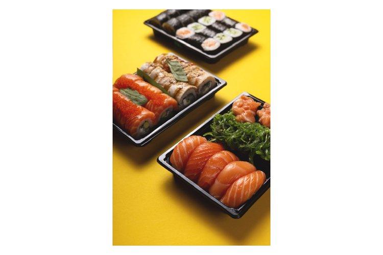 Bright beautiful sushi with fresh fish, caviar and chuka example image 1