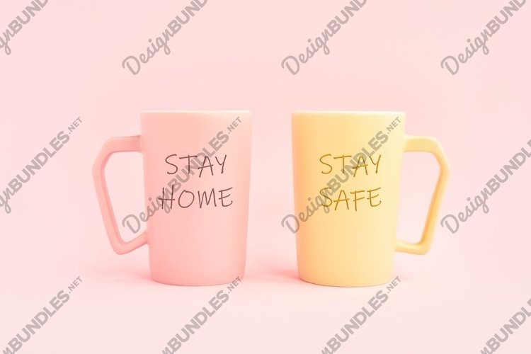 STAY HOME and STAY SAFE written on two cup of coffee