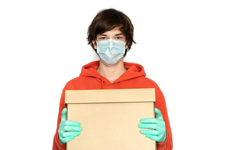 Contactless delivery. A man in a medical mask and gloves