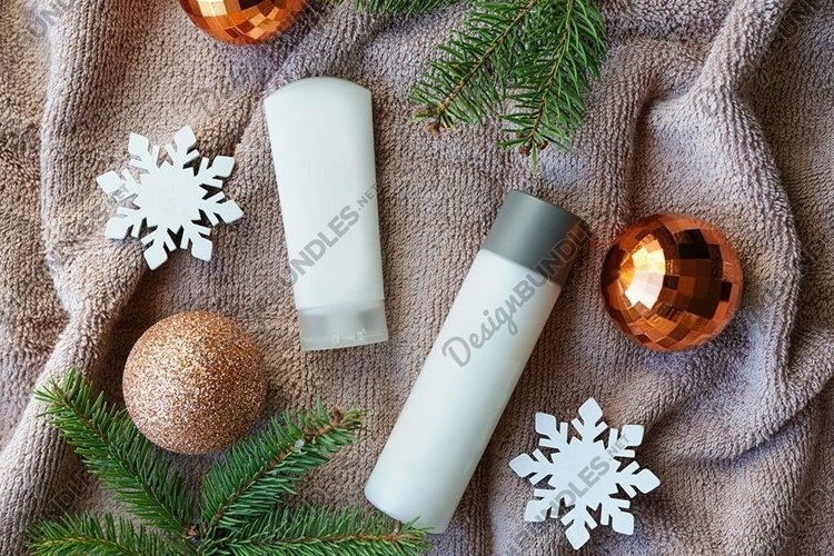 christmas cosmetic products on towel, flat lay. Winter care example image 1