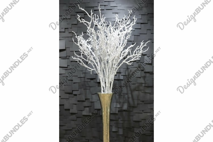 Artificial a snowy branch flowers in a pot on a dark example image 1