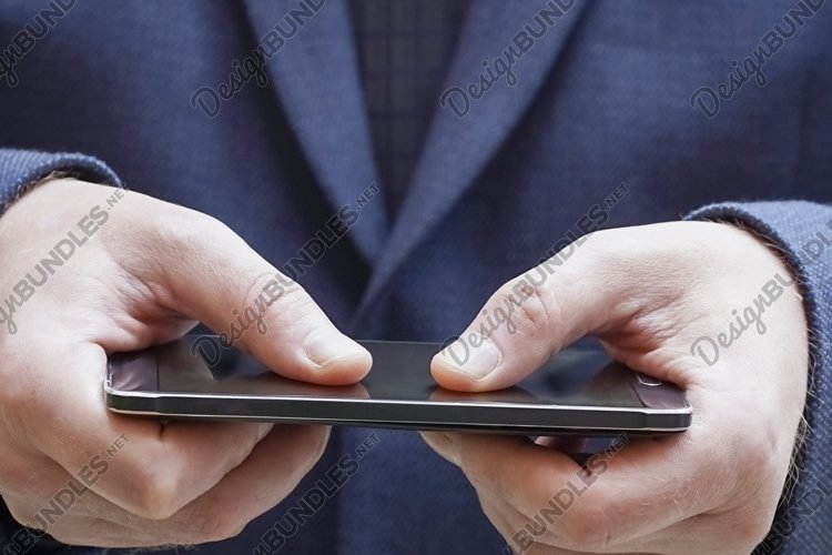 Blurred Close up of a man using mobile smart phone example image 1
