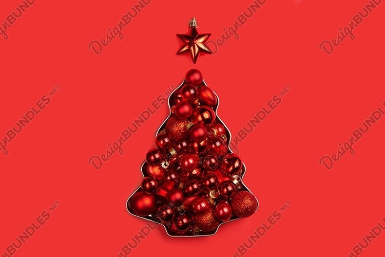 Red Christmas balls lie in the shape of a Christmas tree example image 1