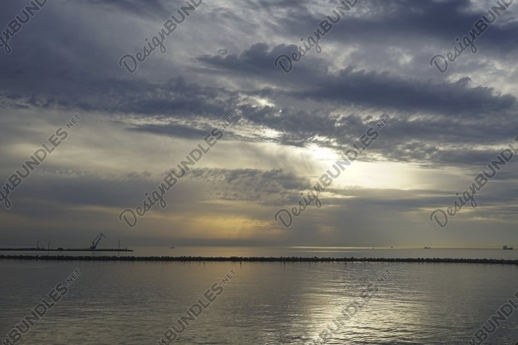 Seascape with a dramatic evening sky. example image 1