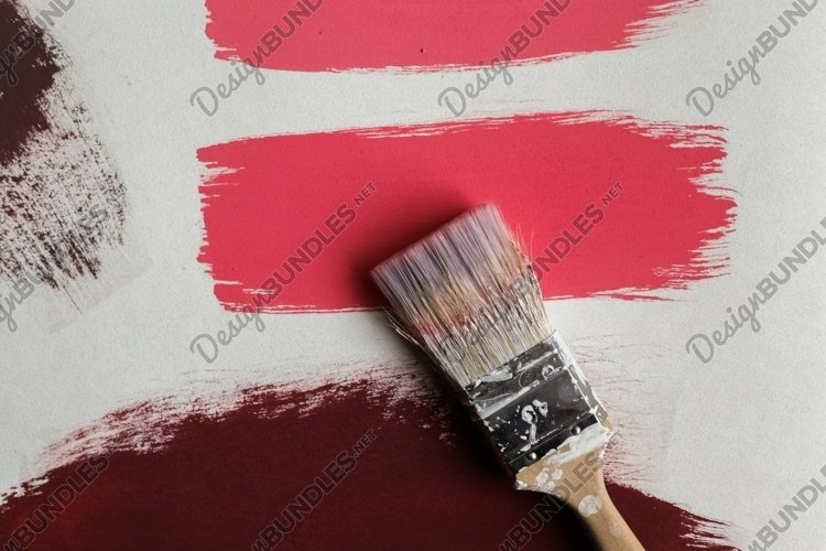 Paint strokes on a piece of paper in red and brown
