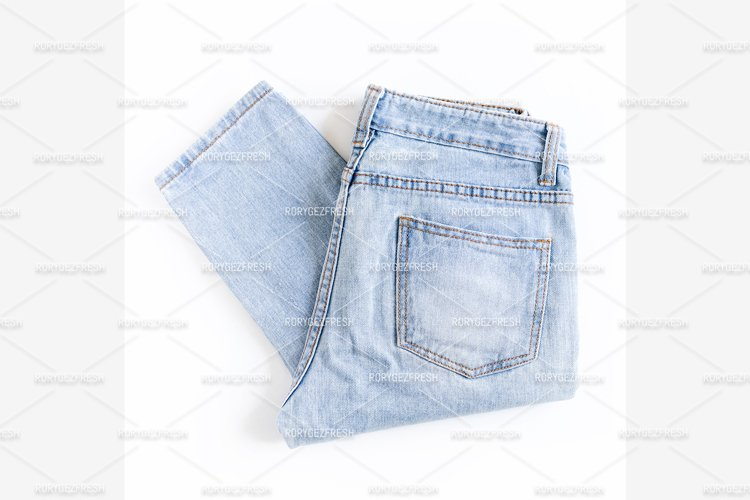 Blue jeans on a white background example image 1
