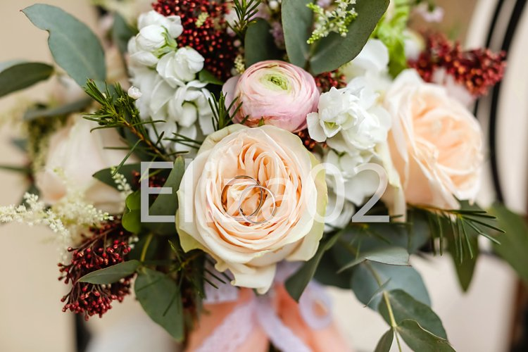 Wedding rings, delicate bouquet of roses for the bride example image 1