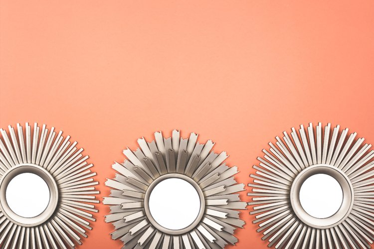 Interior wall mirror in the shape of a sun with metal brass.