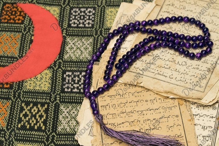 Muslim prayer beads with ancient pages from the Koran example image 1