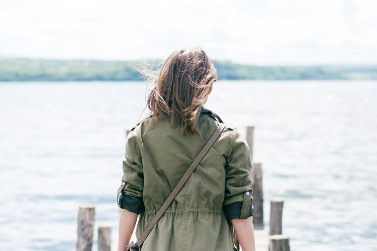 Hipster girl on a wood pier example image 1