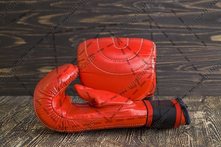 a pair of red boxing gloves example image 1