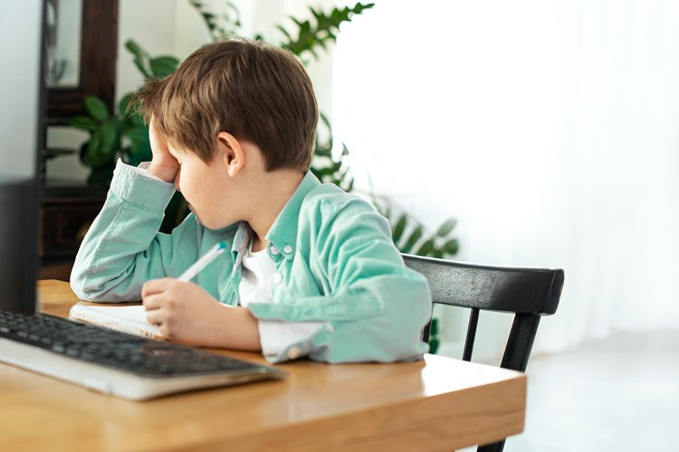 Kids and gadgets. Distance learning. Upset boy example image 1