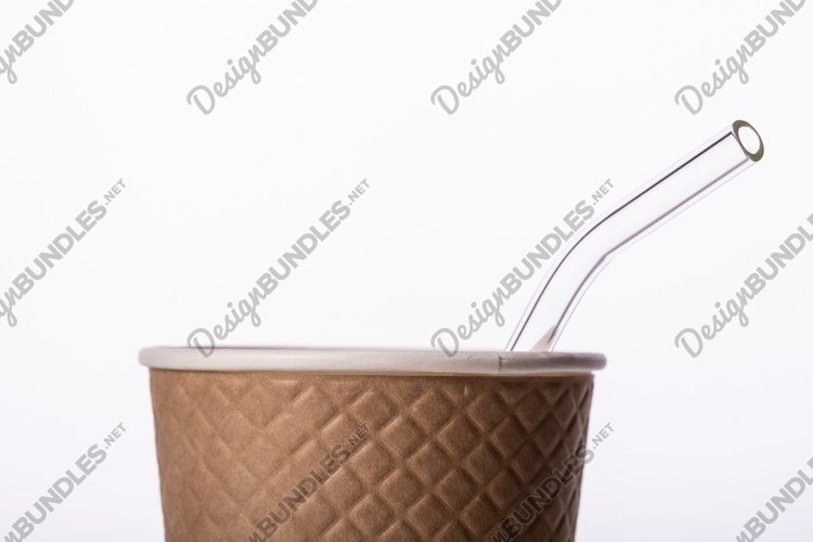 glass reusable straw sticking out of disposable paper cup example image 1