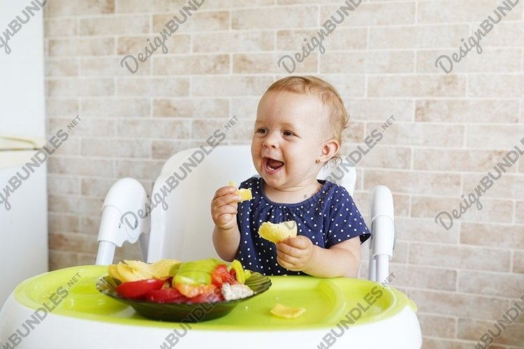 Adorable baby girl eating fresh vegetables and cheese example image 1