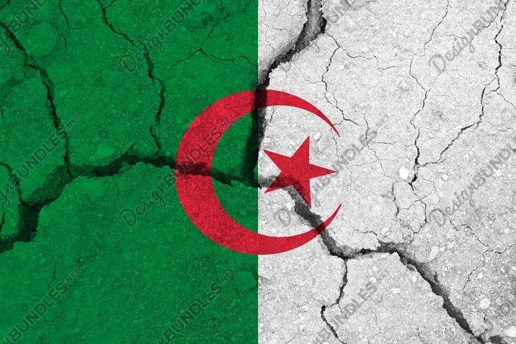 Algeria flag on the cracked earth
