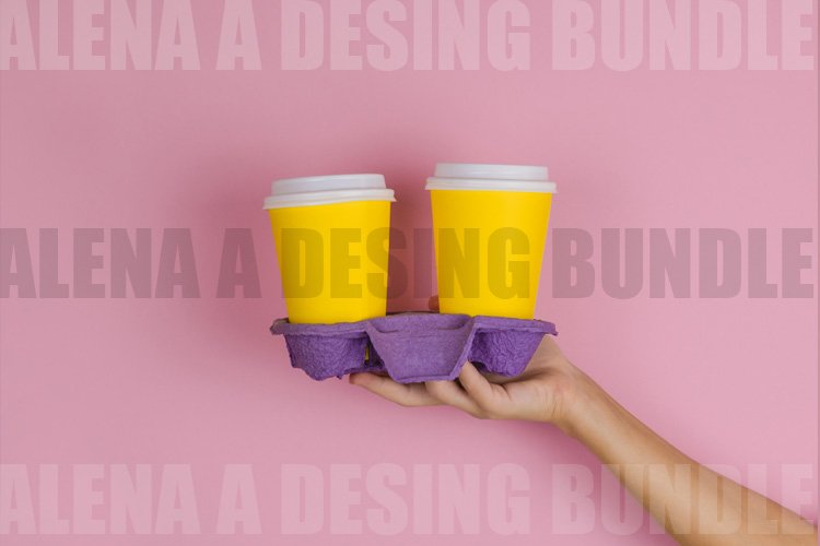 hand holding coffee holder with two takeaway drinks example image 1