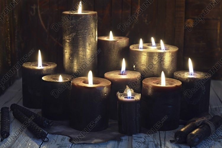 Still life with black candles