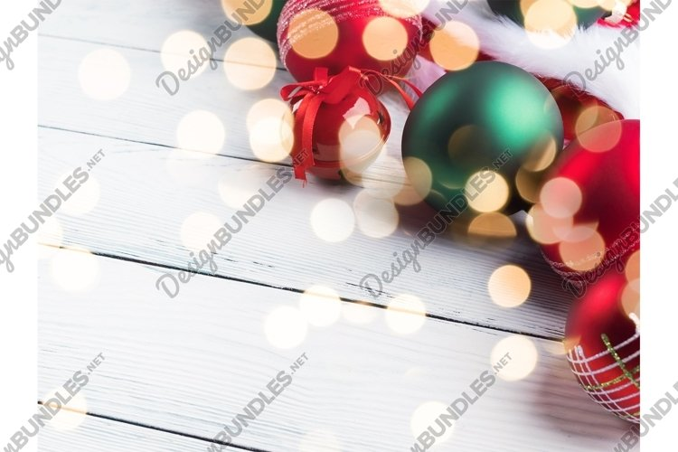 Christmas red green decor on santa claus cap on white table
