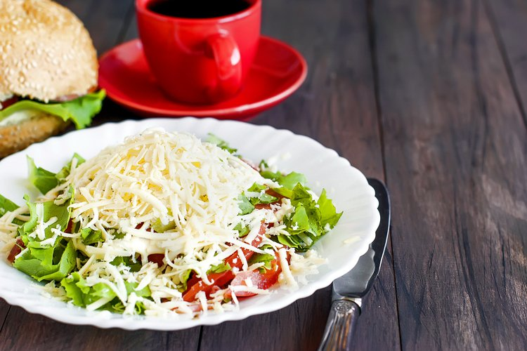 salad with tomatoes, greens sprinkled with cheese