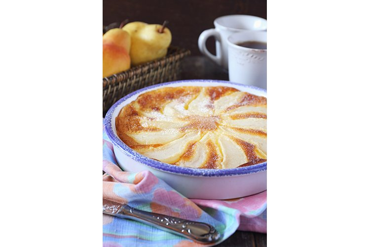 French cuisine. Pear clafoutis and two cup of tea