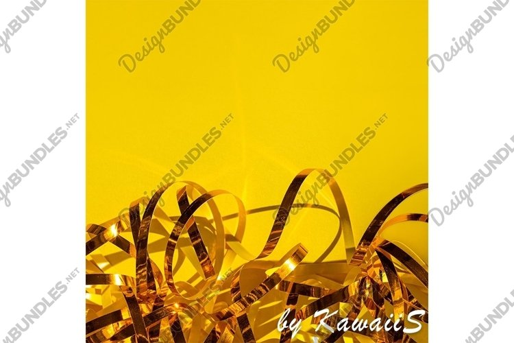 Festive yellow background Golden shiny ribbons texture example image 1