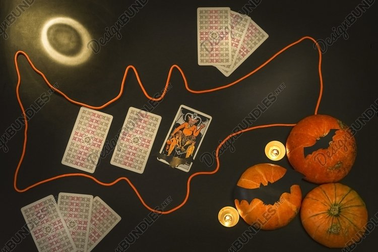 Halloween concept with pumpkins and candles, black magic example image 1