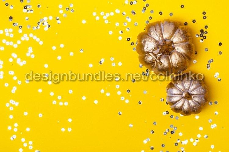 Halloween background with golden pumpkins