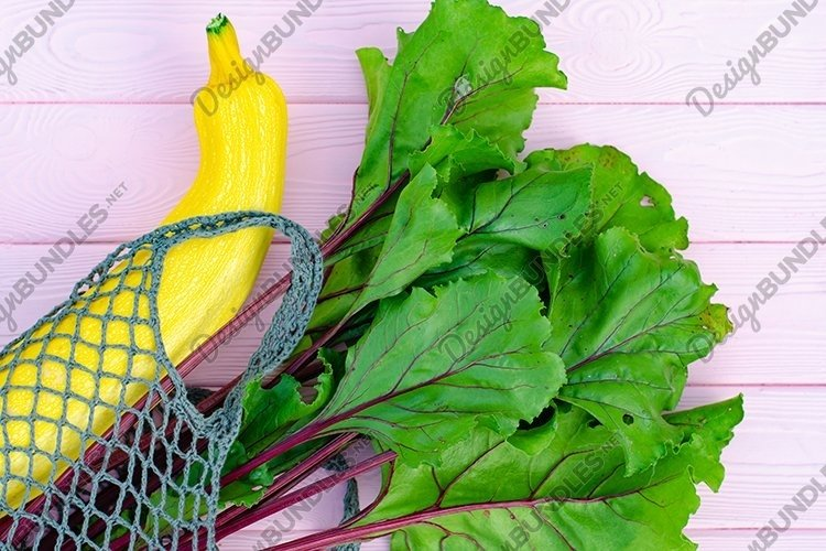 Autumn composition with yellow and green vegetables in bag. example image 1