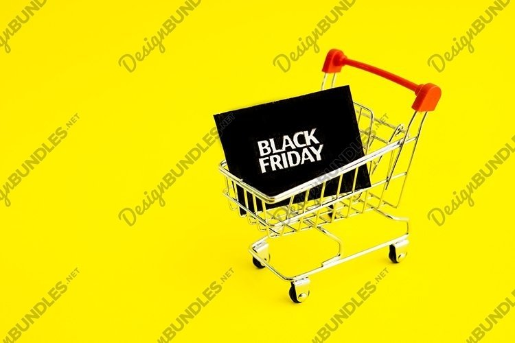 Shopping cart, and black Friday on yellow background example image 1